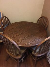 Solid oak 6 seater dining table with 6 chairs
