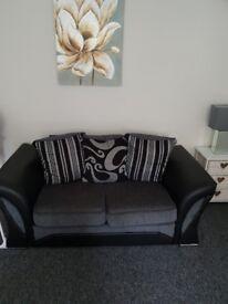 Black and grey 3&2 sofa
