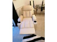 Cream leather armchairs