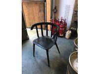 27 Black plastic armchairs