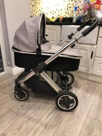 Sliver/grey Oyster 2 pram, comes with carrycot, push chair, wheels, cosytoe and original rain cover.