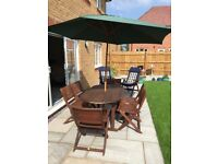 Wooden Table, 6 Chairs and 2 Reclining Chairs incl Seat Cushions, Large Umbrella and Stand
