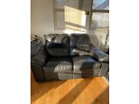 2 black leather sofa set, (recliner) good condition