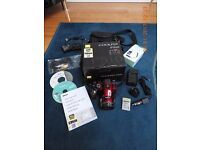 NIKON P510 42 X OPT ZOOM CAMERA. METALLIC RED + NIKON CARRY CASE, SPARE BATTERY & CHARGER. BOXED.