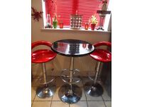 Breakfast bistro table and 2 red stools