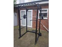 Squat rack with pull up bar and weights in Weybridge, Surrey. Not Ruislip