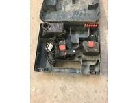 Bosch electric drill charger and 2 c batteries in case