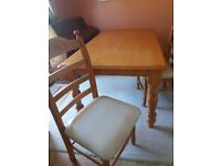 Wooden table and 4 matching chairs