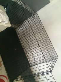 Extra large dog cage, few bars bent out of shape on the door easily bent back though p