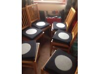 6 solid wood chairs, with tweed removable pads.