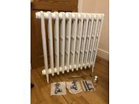 Brand new cast iron radiator with valves and shrouds