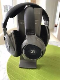 Sennheisser two wireless rechargeable headphones + transmitter connected to TV/Streo System. A steal