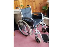 WHEEL CHAIR self or attendant propelled hardly used including shopping bag