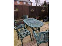 Heavy cast table with 6 chairs