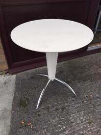 White plastic round table