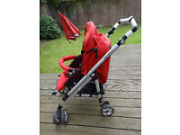 Red baby pushchair (buggy) – from 6 months until 3 Y
