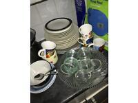 Plates, cereal bowls, mugs, glass bowl and ramekins