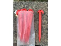 10x red plastic tent/awning pegs