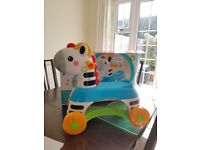 Fisher Price Rollin' Tunes Zebra ride on