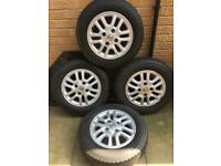 Nissan 14 inch alloy wheels and good tyres