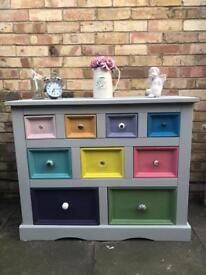 Multicolour chest of drawers painted in Annie Sloan