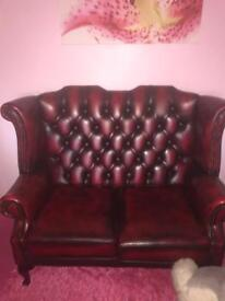 Two seater leather settee Ox blood in colour