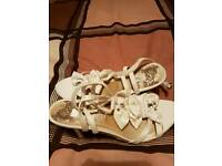 Ivory sandals suitable for a wedding