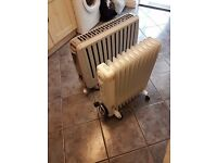 2 x portable electric heaters