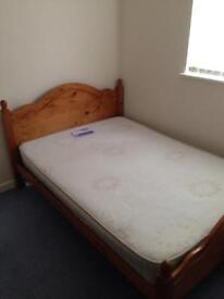 Wooden double bed frame and mattress