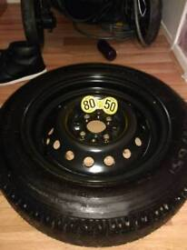 Four spoke space saver spare tyre with alloy