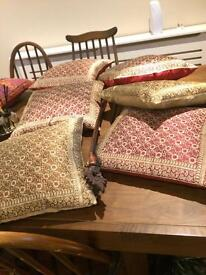 6 cushions with gold brocade cover.
