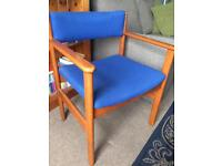 2 solid wooden chairs with blue upholstery