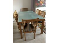 Dinning table and six chairs in excellent condition