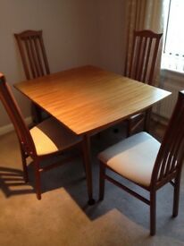 Extendable dining table and 4 x solid wooden chairs