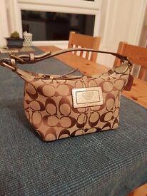 Small gold Coach handbag