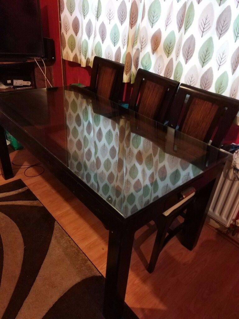Dark brown antique style oak dinning set table with glass and 6 chairs