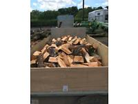 Seasoned hardwood split logs for sale.