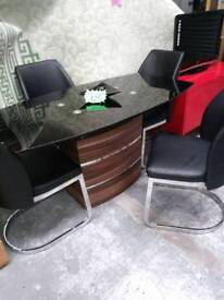 Very modern black glass dining table with chairs