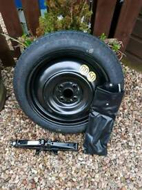 Space saver tyre. Comes with a jack. As new condition. Never used.