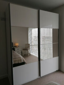 Wardrobe. Contemporary large double sliding with mirrors.