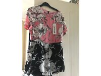 BRAND NEW WITH TAGS FLORAL PLAYSUIT SIZE 12
