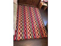 Large, multi coloured rug
