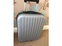 Silver pull along cabin suit case New