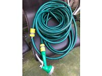 Garden hose pipe with fittings and water gun