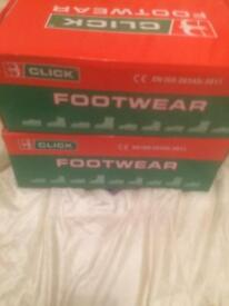 Size nine black working boots bran new in there box