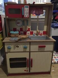 Kids wooden kitchen and playfood