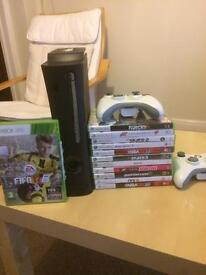 Xbox 360 with various games.