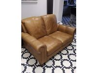 Two seater real leather sofa pale tan