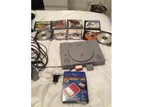 PlayStation one with variety of games