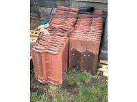 Red roof tiles. 55 tiles and 2 vent tiles used